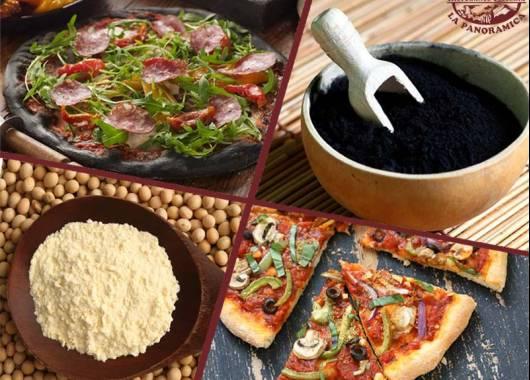 Pizzeria con pizza al carbone vegetale e pizza con farina di soia